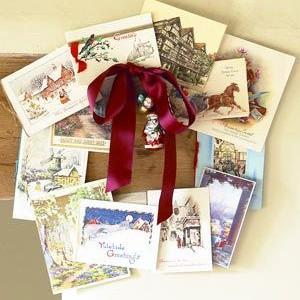 Idėja namams: kalėdinis vainikas iš atviručių