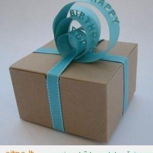 Pakuojame kalėdines dovanas – į ką?